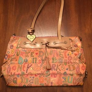 Tan and pink patterned Dooney & Bourke Handbag